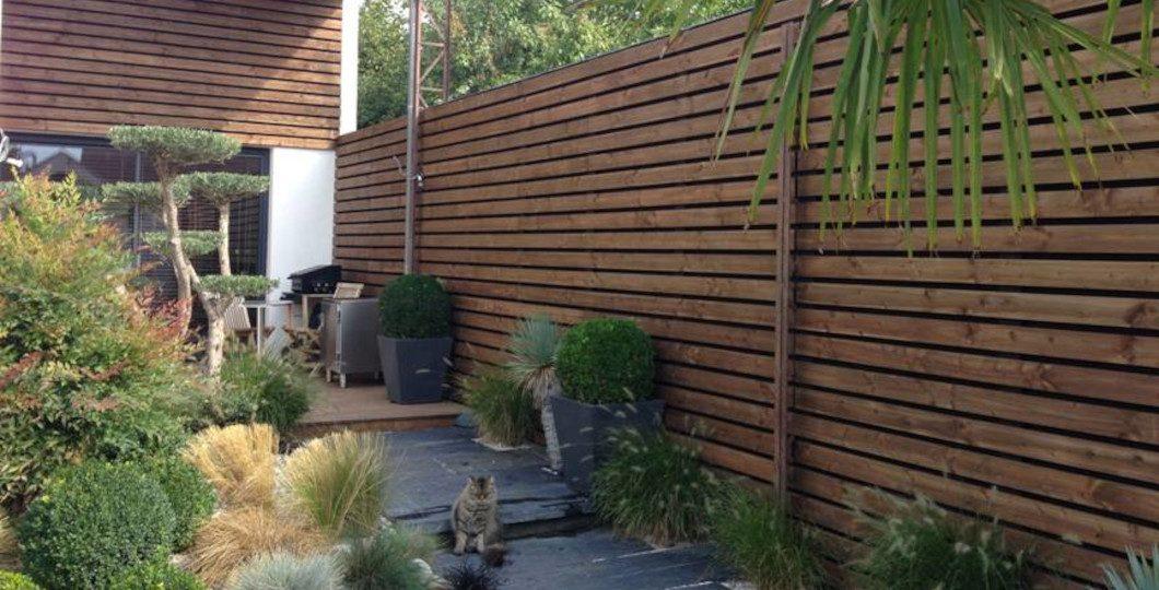 Bardage claire-voie Douglas marron façade et clôture